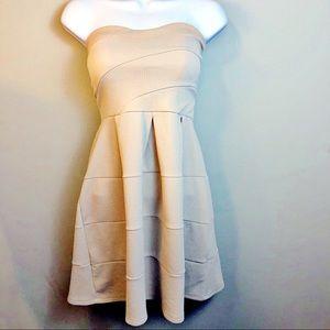 Stunning Nude Strapless Dress with an Empire Waist